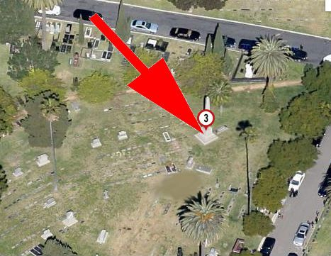 An aerial view of the Hollywood Forever cemetery. There is a red arrow pointing to a large gravestone which is numbered with the number three. There are trees on the perimeter of the cemetery.