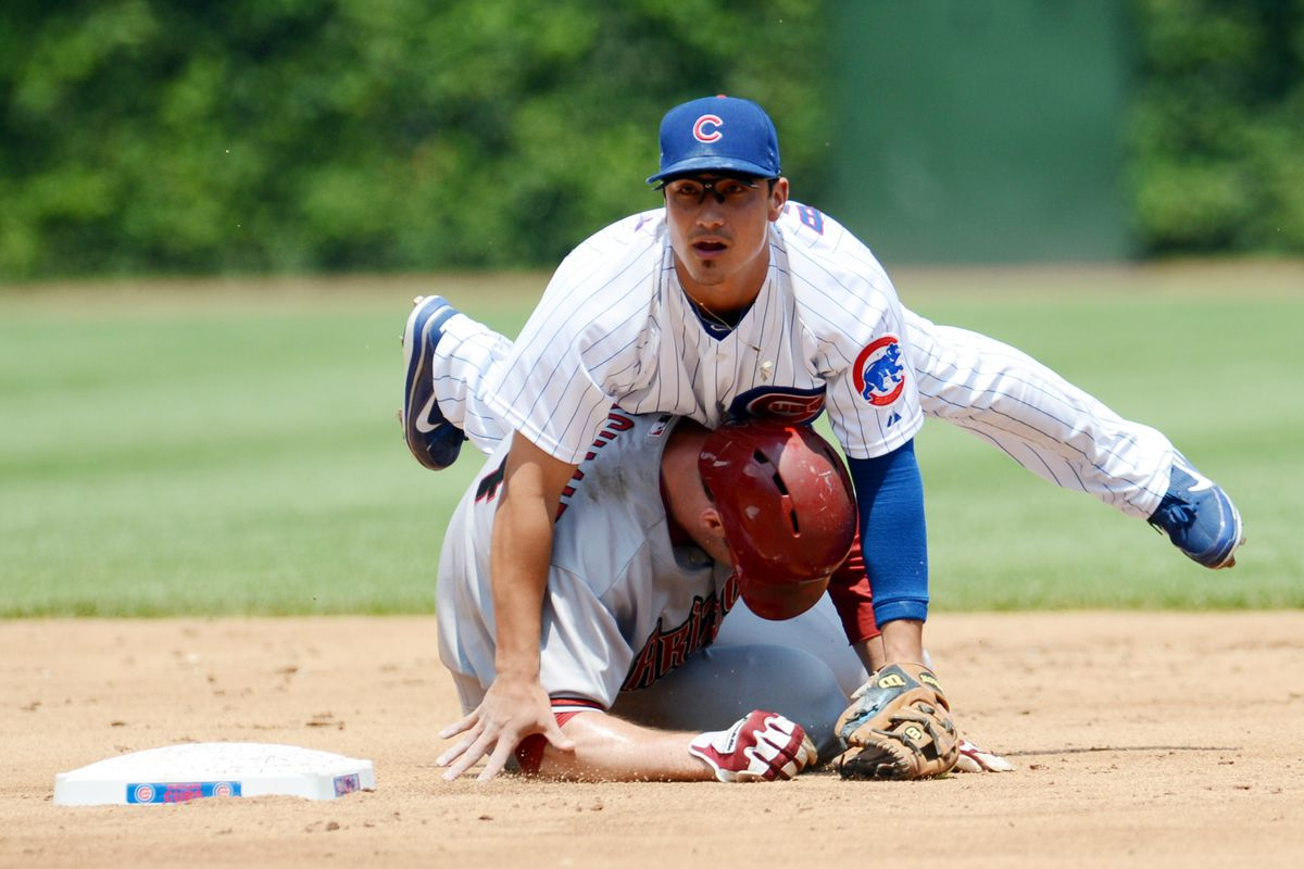 Chicago, IL, USA; Chicago Cubs second baseman Darwin Barney falls on top of Arizona Diamondbacks first baseman Paul Goldschmidt after turning a double play at Wrigley Field. Credit: Jerry Lai-US PRESSWIRE