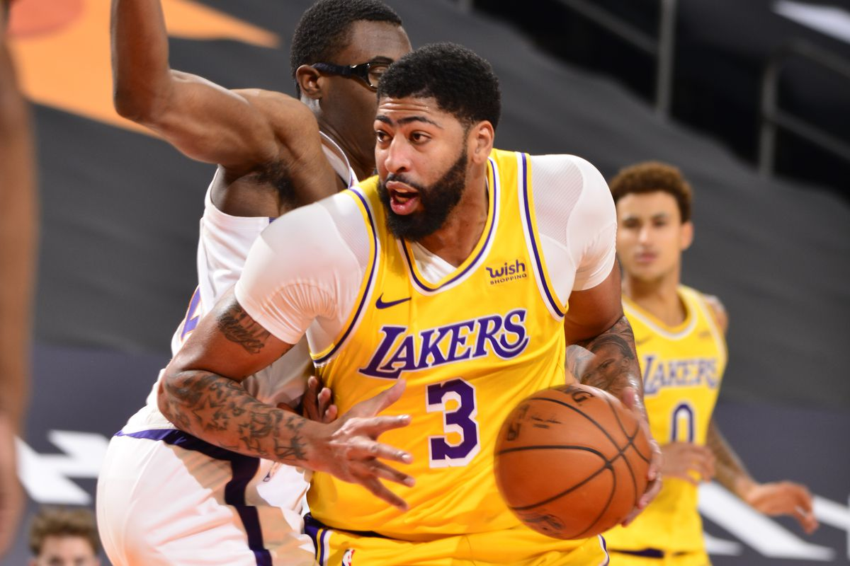 Anthony Davis #3 of the Los Angeles Lakers drives to the basket against the Phoenix Suns during a preseason game on December 18, 2020 at Talking Stick Resort Arena in Phoenix, Arizona.