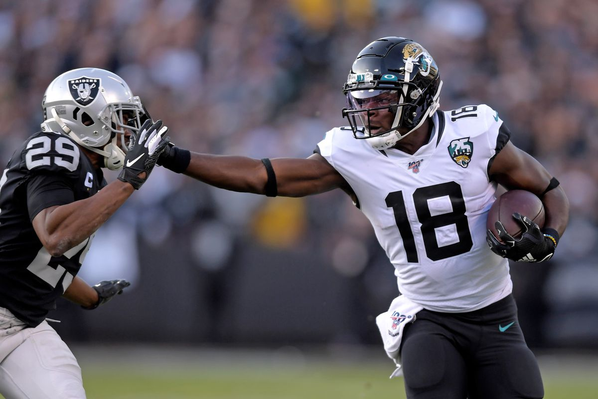 Jacksonville Jaguars wide receiver Chris Conley stiff arm Oakland Raiders free safety Lamarcus Joyner for a touchdown during the Raiders final game at the Oakland-Alameda Coliseum before relocating to Las Vegas for the 2020 season. The Jaguars defeated the Raiders 20-16.