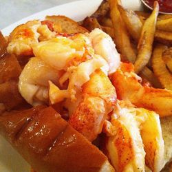 """Warm butter poached lobster roll at Neptune Oyster Bar by  <a href=""""http://www.flickr.com/photos/chefguchi/"""">yodi2012</a>."""