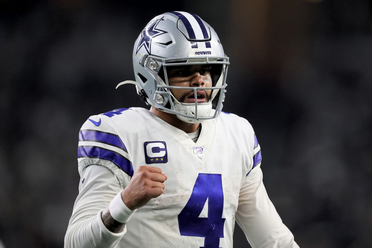 Dak Prescott #4 of the Dallas Cowboys celebrates in the third quarter against the Washington Redskins in the game at AT&T Stadium on December 29, 2019 in Arlington, Texas.
