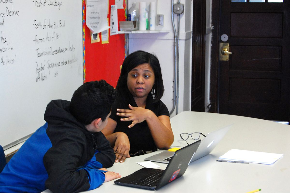 Eighth-grade teacher Traci McCullough meets one-on-one with a student in February 2020 as part of a mentoring session at Chicago International Charter School Bucktown, an early adopter of the Summit Learning program.
