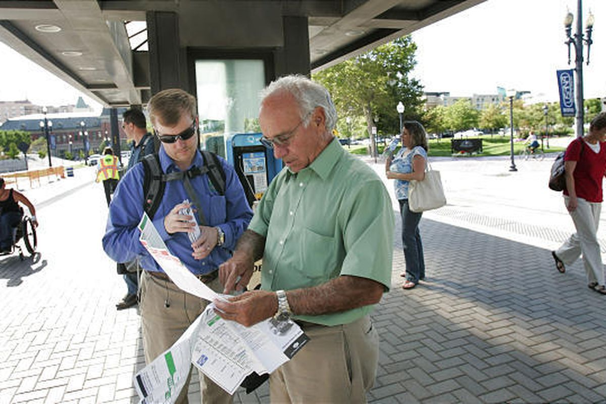 Trevor Nielson, left, and John Gonzales look at a new route map at UTA's Arena TRAX Station in Salt Lake City on Monday.