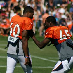 Broncos rookie CB Aaron Hester gets a lesson from Dominique Rodgers-Cromartie before the sixth day of training camp begins