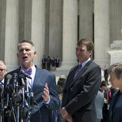 Kentucky plaintiffs Michael De Leon, left, and his husband Gregory Bourke, center,  speak with reporters while attorney Douglas Hallward-Driemeier, center right, and civil rights lawyer Mary Bonauto, right, look on in front of the Supreme Court following a hearing on same-sex marriage, in Washington, Tuesday, April 28, 2015. The opponents of same-sex marriage are urging the court to resist embracing what they see as a radical change in society's view of what constitutes marriage.
