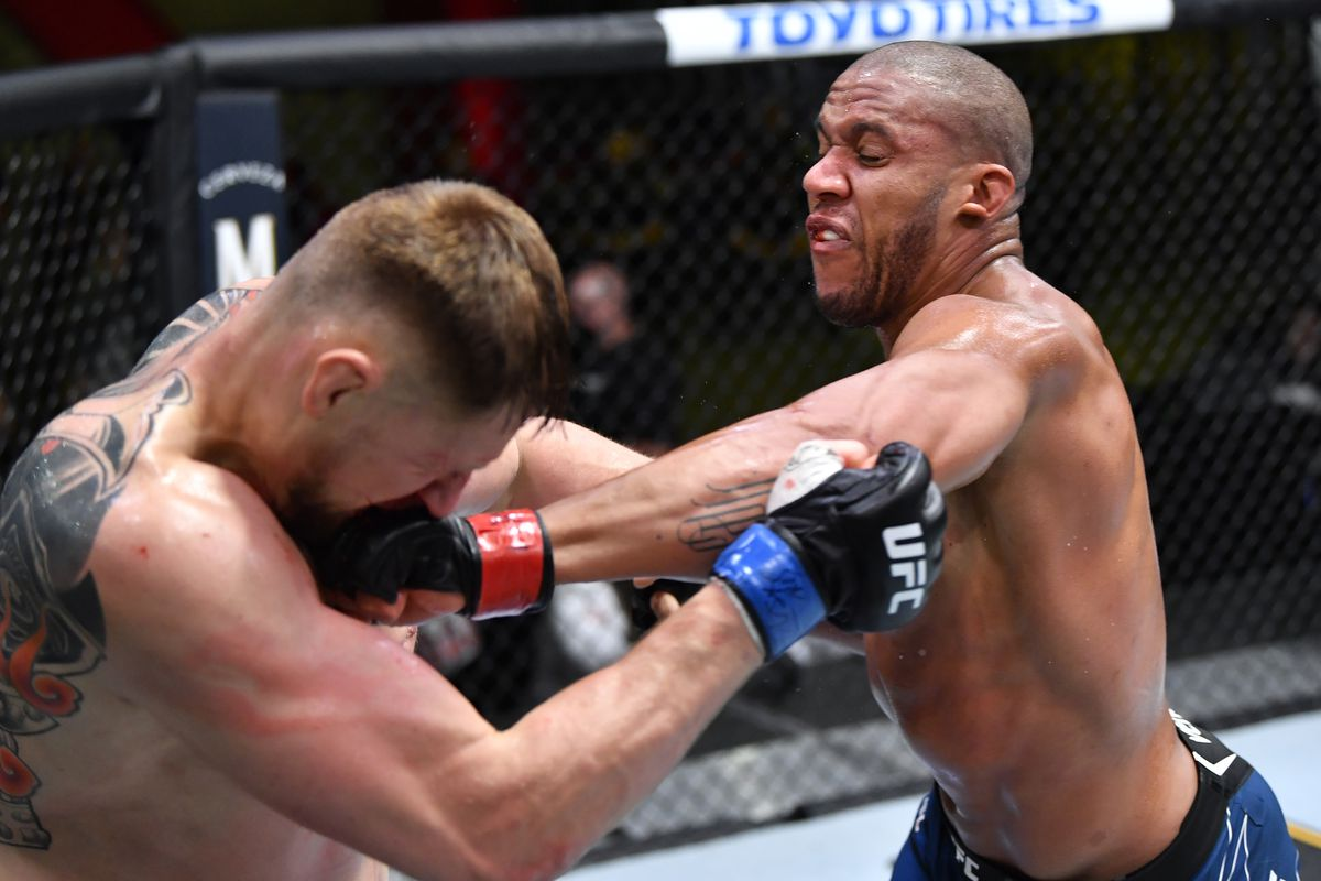 Ciryl Gane of France punches Alexander Volkov of Russia in a heavyweight fight during the UFC Fight Night event at UFC APEX on June 26, 2021 in Las Vegas, Nevada.