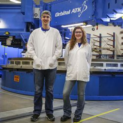 Katlynn Simpson, right, and Ben Larsen, left, members of the Utah Aerospace Pathways Program, are pictured in the radial room at the Orbital ATK manufacturing facility in Clearfield on Thursday, April 20, 2017.