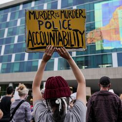 Naima Antolin, center, and other protesters gather outside the Salt Lake County District Attorney's Office building in Salt Lake City on Saturday, June 13, 2020. The day's demonstrations were the latest in ongoing protests against racism and police brutality that have followed the killing of George Floyd in Minneapolis.