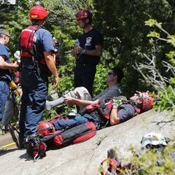 Members of the Salt Lake County Search and Rescue team rest after efforts to recover the body of a 22-year-old hiker who fell in Bell Canyon were halted on Monday, June 5, 2017. Siaosi Brown's body was spotted in the lower falls of the canyon. His body was trapped on some logs in the middle of the waterfall, Unified Police Lt. Brian Lohrke said.