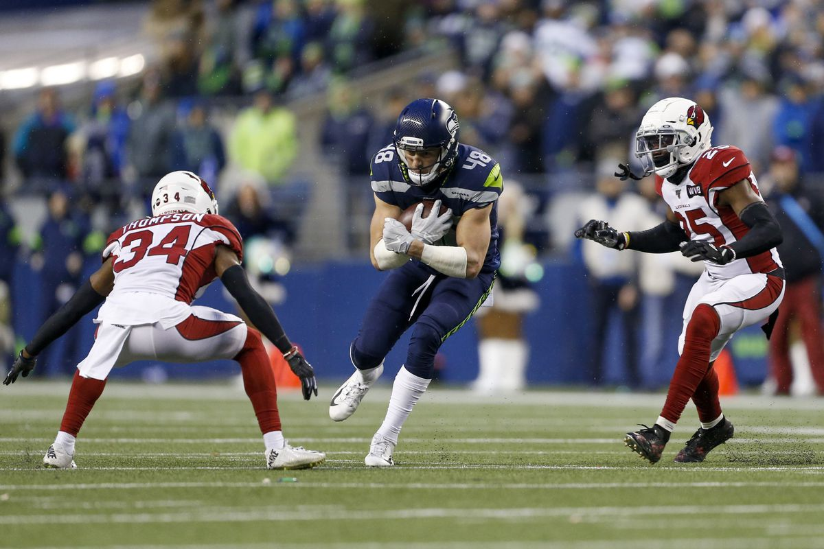 Seattle Seahawks tight end Jacob Hollister runs for yards after the catch before being tackled by Arizona Cardinals strong safety Jalen Thompson and defensive back Chris Jones during the fourth quarter at CenturyLink Field.