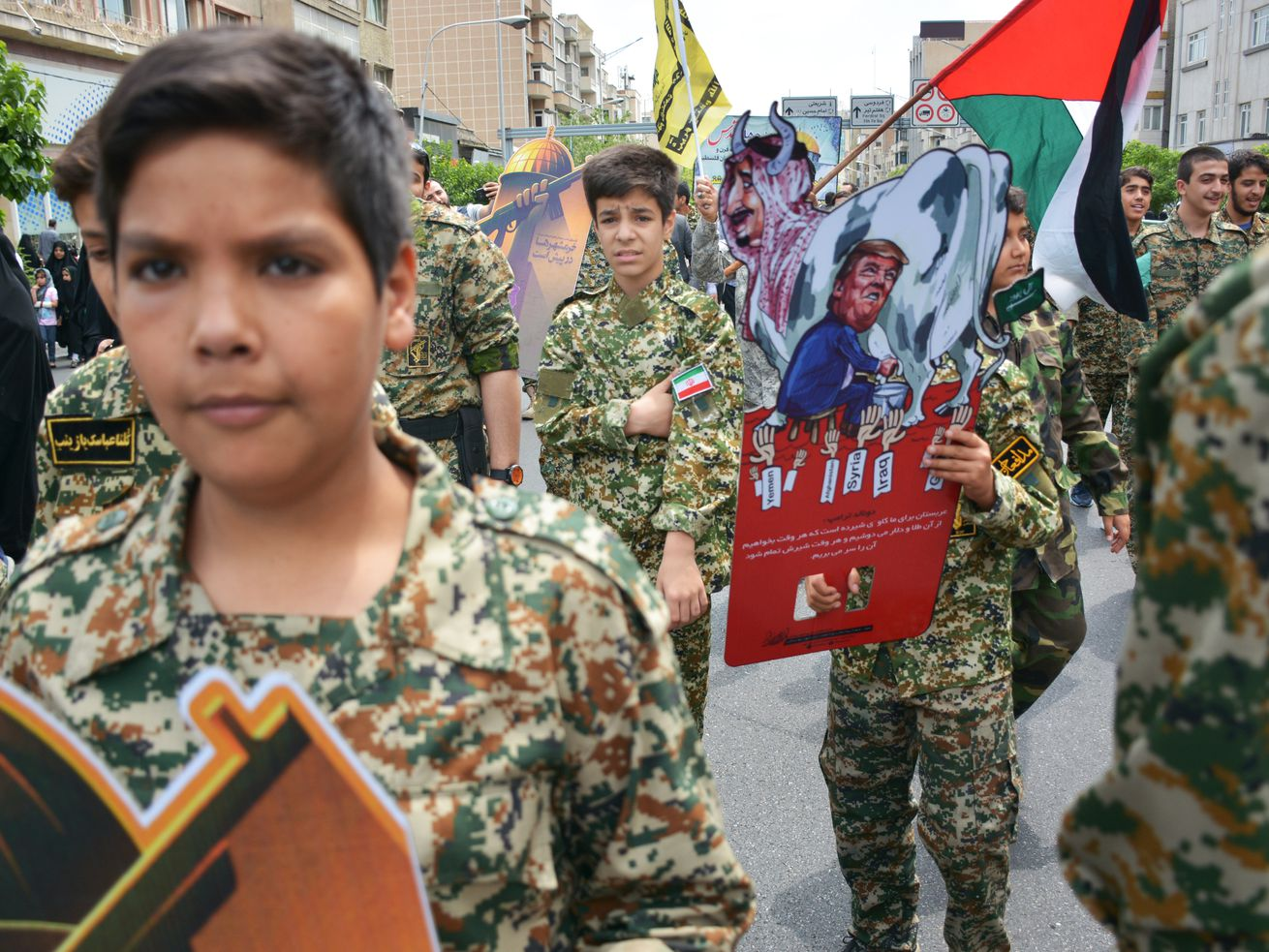 Members of an Iranian paramilitary force rally in Tehran in May.