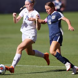 Skyline's Laura Cookson, left, and Bonneville's Summer Diamond jockey for position on the ball as the two schools play in 5A girls soccer state semifinal action at Rio Tinto Stadium in Sandy, Utah, on Tuesday, Oct. 20, 2020. Bonneville won 2-0.