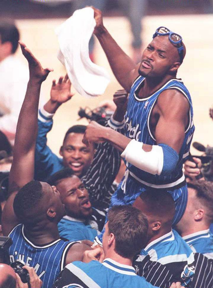 Orlando Magic forward Horace Grant(top) is lifted