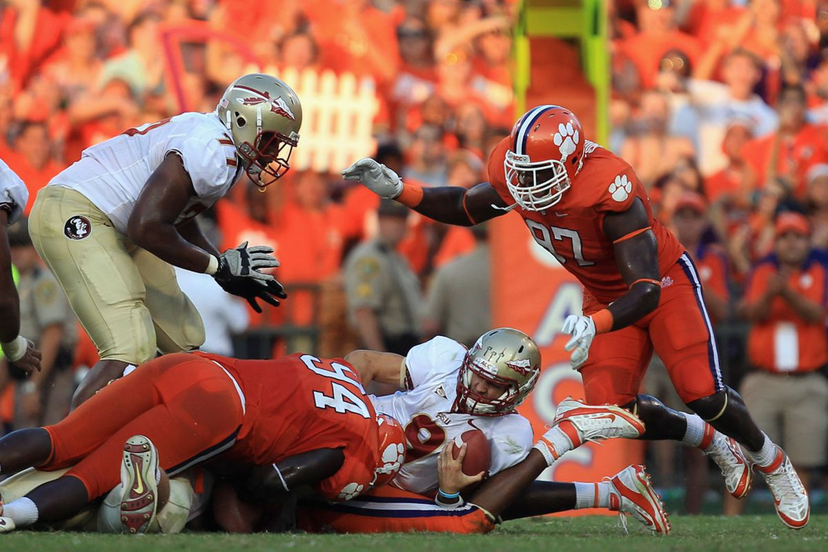 CLEMSON, SC - SEPTEMBER 24:  Clint Trickett #9 of the Florida State Seminoles is sacked by the Clemson Tigers during their game at Memorial Stadium on September 24, 2011 in Clemson, South Carolina.  (Photo by Streeter Lecka/Getty Images)