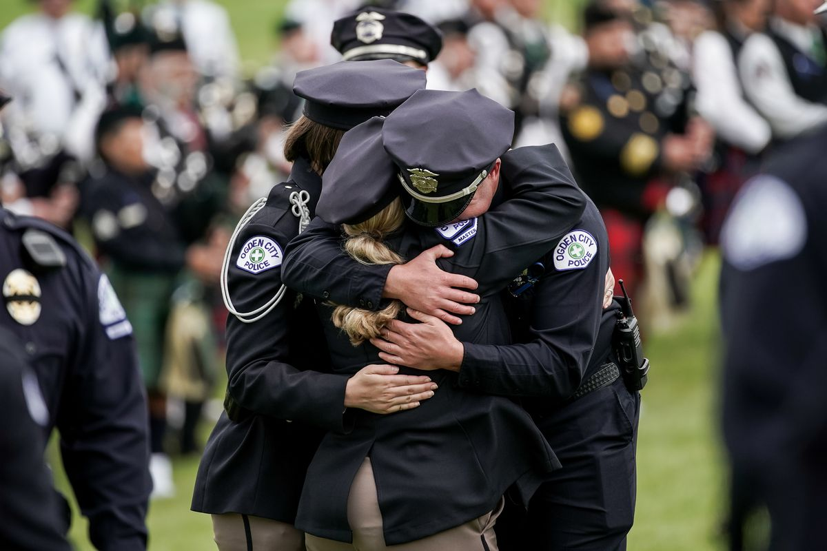 Ogden police officers embrace at the graveside service for Ogden police officer Nathan Lyday at Lindquist Memorial Gardens of the Wasatch in Ogden on Saturday, June 6, 2020. Lyday was shot and killed May 28 while responding to a domestic violence call.