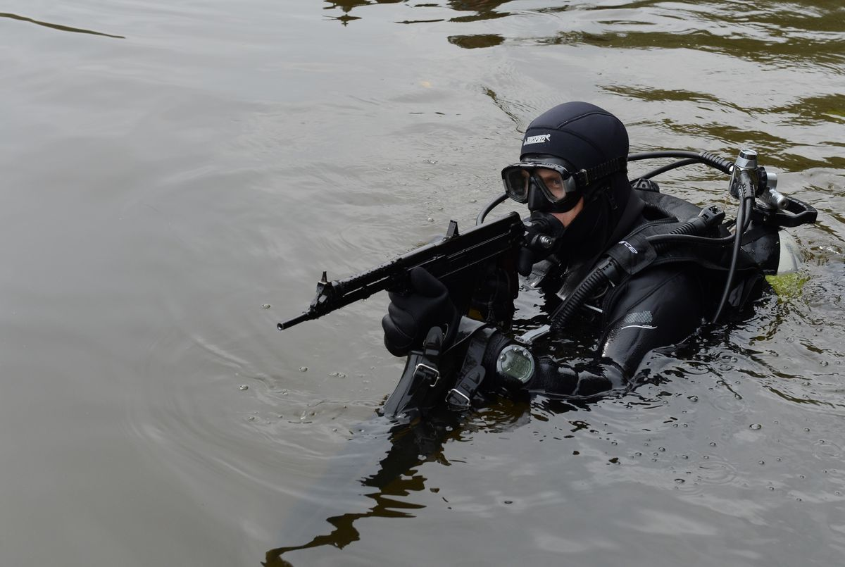 Military diver with gun