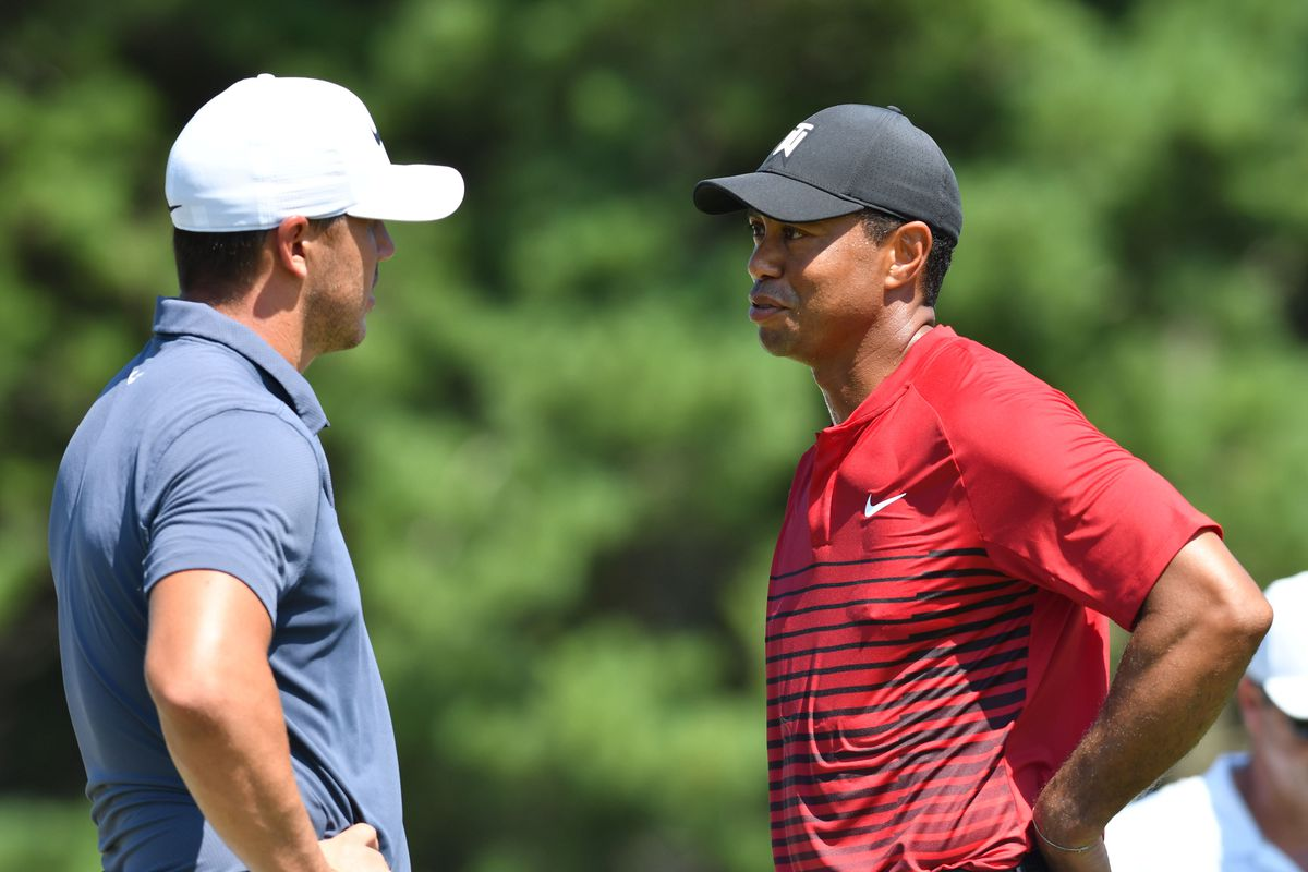 Tiger Woods has a conversation with Brooks Koepka on the 3rd hole during the final round of the Dell Technologies Championship golf tournament at TPC of Boston.