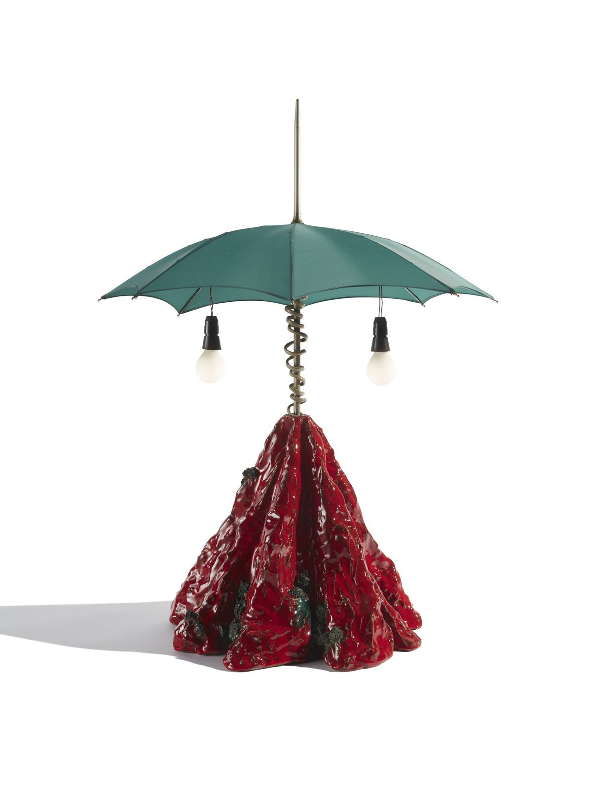 A lamp with a red hand-formed ceramic base and teal umbrella for a shade.