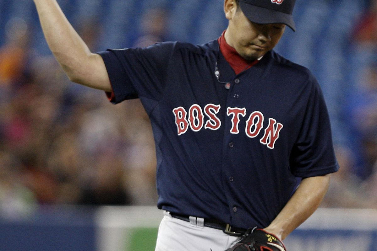 TORONTO, CANADA:  Daisuke Matsuzaka #18 of the Boston Red Sox reacts to issuing a walk against the Toronto Blue Jays during MLB action at the Rogers Centre in Toronto, Ontario, Canada.  (Photo by Abelimages/Getty Images)