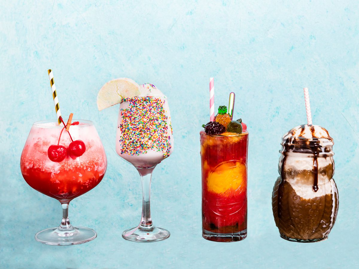 A blue background with four colorful cocktails, including a red one with cherries, a sprinkled one, and one with chocolate.