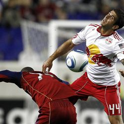 HARRISON, NJ - SEPTEMBER 21:  Carlos Mendes #44 of the New York Red Bulls heads the ball in front of Andy Williams #77 of the Real Salt Lake during their game at Red Bull Arena on September 21, 2011 in Harrison, New Jersey.  (Photo by Jeff Zelevansky/Getty Images)