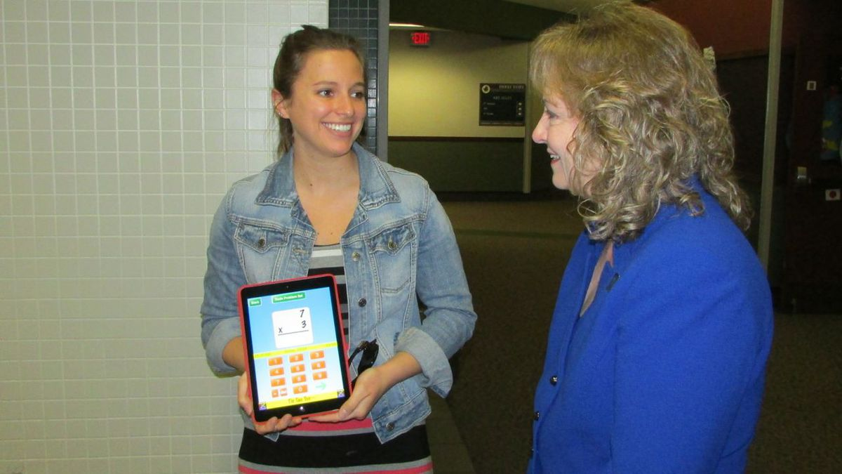 A Central Elementary School teacher shows state Superintendent Glenda Ritz how she uses an iPad to give kids extra math practice while they stand in line to use the bathroom.