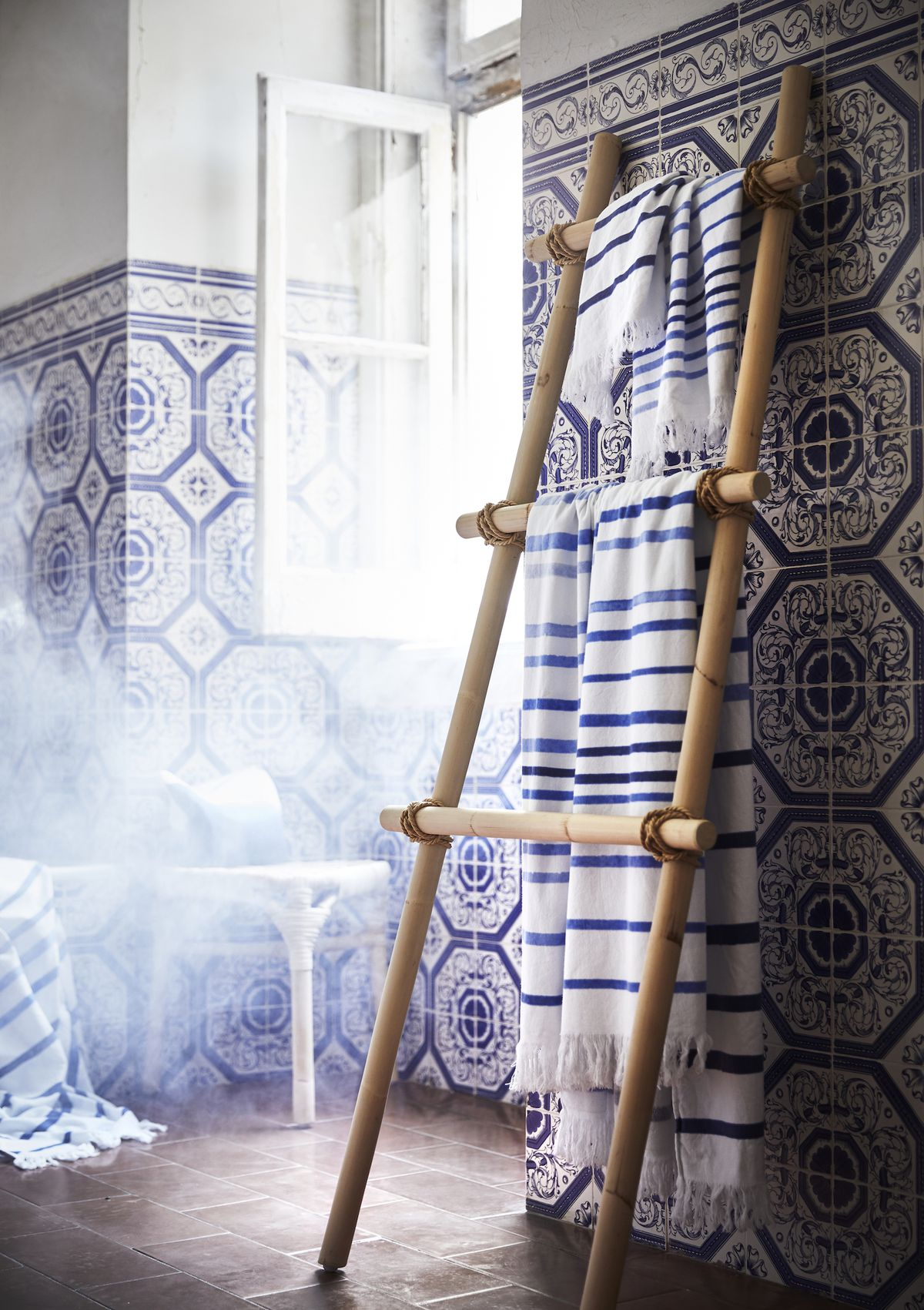 Blue and white throw on wooden ladder