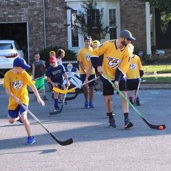 Nick Bonino waits for his winger so they can begin their attack during an intense game of street hockey in Nolensville.
