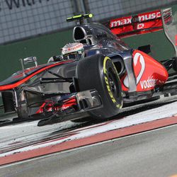 McLaren Formula One driver Lewis Hamilton of Britain steers his car across the chicane during the first practice session for the Singapore Formula One Grand Prix on the Marina Bay City Circuit in Singapore, Friday, Sept. 21, 2012.