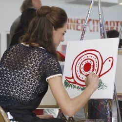 Duchess of Cambridge Kate Middleton paints a snail.