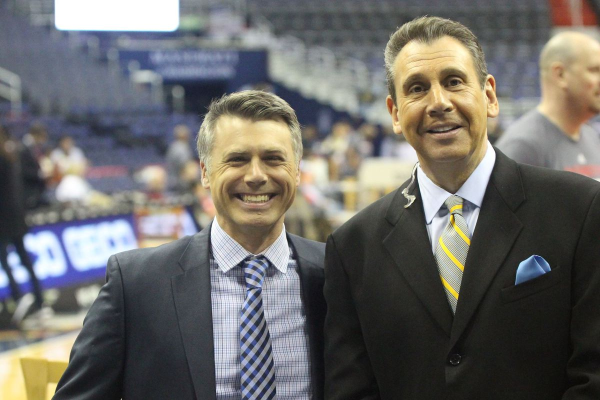 Frank Hanrahan and Glenn Consor of the Wizards broadcasting team take a pic.