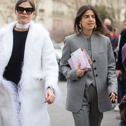 Emily Weiss (left) in a Saks Potts coat and Leandra Medine of Man Repeller in a Rosie Assoulin suit and Glossier pouch.