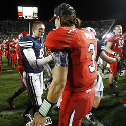 BYU's #9 Jake Heaps shakes hands with Utah #3 Jordan Wynn after the Utes 54-10 win Saturday, Sept. 17, 2011