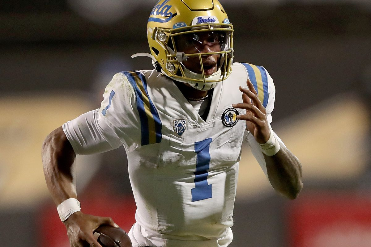 Quarterback Dorian Thompson-Robinson #1 of the UCLA Bruins runs out of the pocket against the Colorado Buffaloes in the fourth quarter at Folsom Field on November 07, 2020 in Boulder, Colorado.