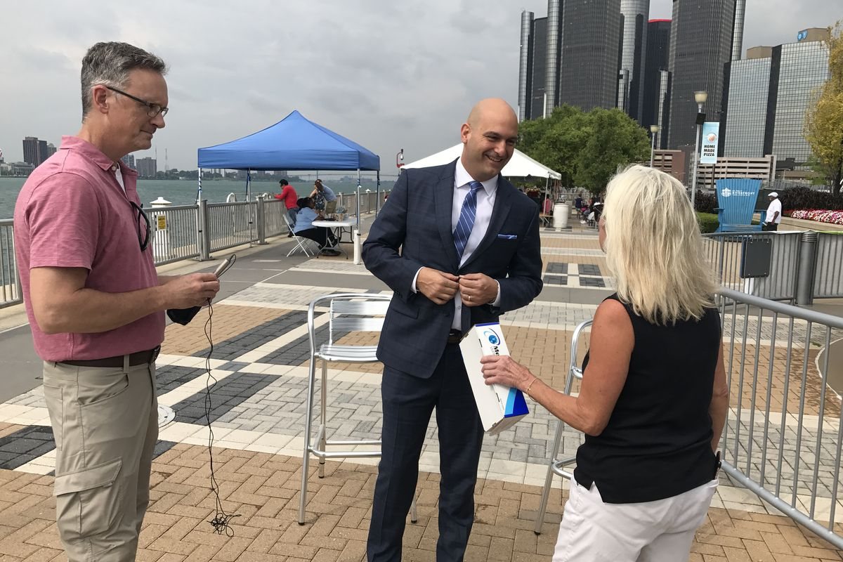 Detroit schools Superintendent Nikolai Vitti prepares for a TV interview on Detroit's RiverWalk in August 2017, before the start of his first school year at the helm of the district.