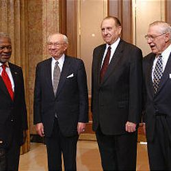 United Nations Secretary-General Kofi Annan, left, is welcomed at LDS Church headquarters by President Gordon B. Hinckley and his counselors in the First Presidency, President Thomas S. Monson and President James E. Faust.