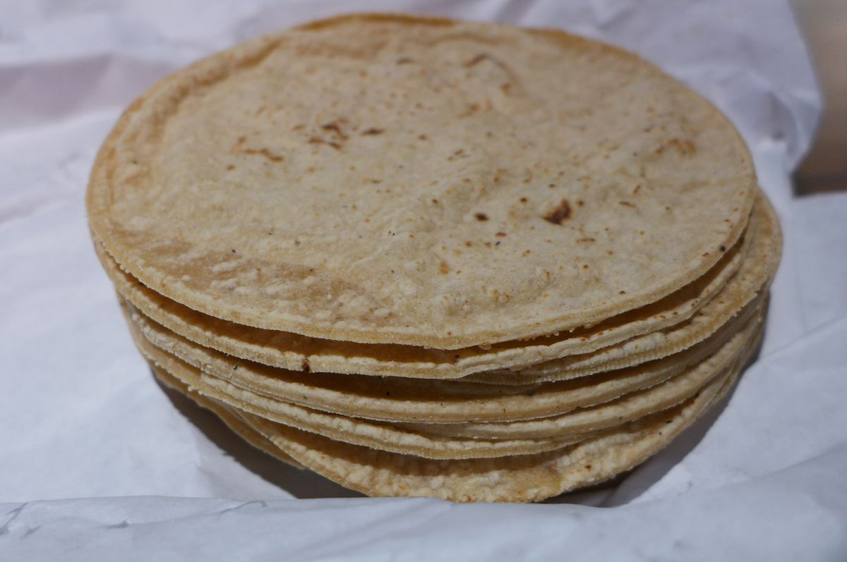 A stack of freshly made tortillas, you can almost see them steaming.