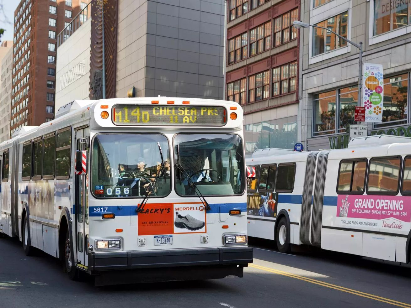 A pair of blue and white M14 buses on 14th Street.