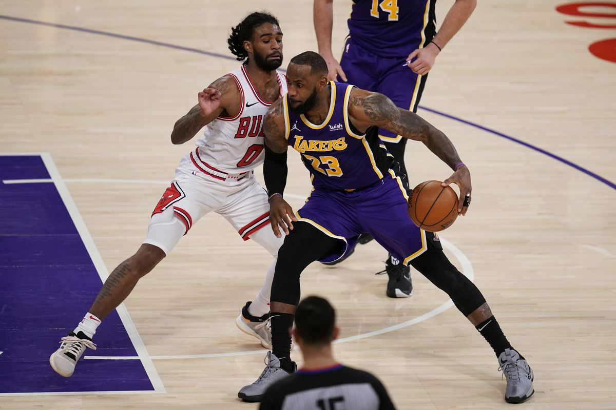 Bulls guard Coby White defends against Los Angeles Lakers forward LeBron James.