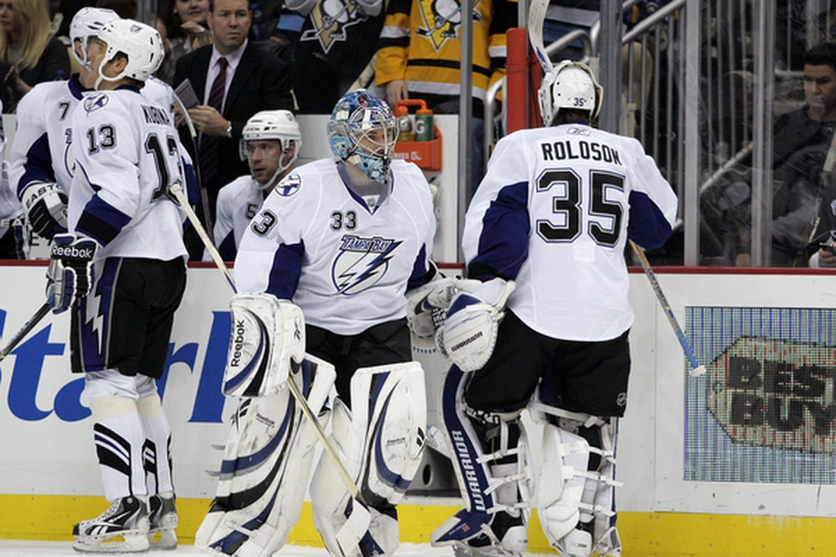 PITTSBURGH PA - JANUARY 05:  Dan Ellis #33 of the Tampa Bay Lightning replaces Dwayne Roloson #35 in net against the Pittsburgh Penguins on January 5 2011 at Consol Energy Center in Pittsburgh Pennsylvania.  (Photo by Justin K. Aller/Getty Images)