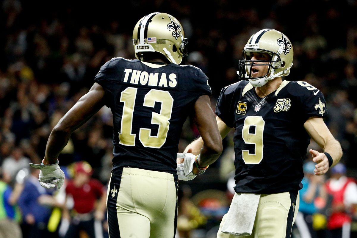 New Orleans Saints quarterback Drew Brees celebrates with wide receiver Michael Thomas after a touchdown against the Los Angeles Rams during the third quarter of a game at the Mercedes-Benz Superdome.