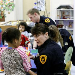 Salt Lake police detective Wendy Willis makes crafts with patients at Primary Children's Medical Center in Salt Lake City on Thursday, Jan. 19, 2012.
