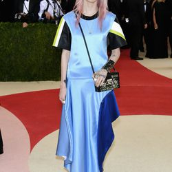 Grimes wears a Louis Vuitton dress.