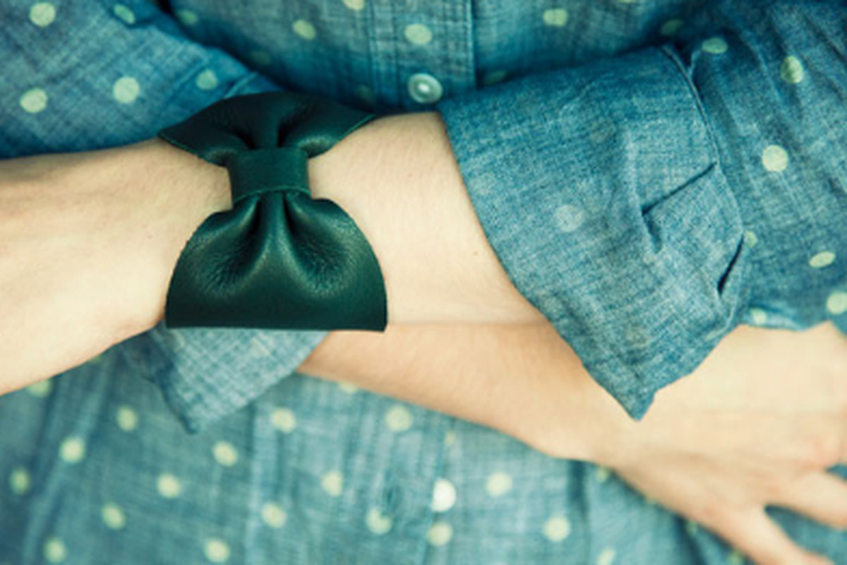 """<a href=""""http://www.ofakind.com/editions/596-NIGHT-SHADE-LEATHER-BOW-CUFF"""">Night Shade Leather Bow Cuff</a>, $70, is $35 today with <a href=""""http://www.luckymag.com/blogs/luckyrightnow/2012/05/DOTD-OfaKind-Gabriela-Artigas-Cuff"""">Lucky</a> code. Imag"""