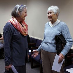 Michele Straube, left, and Gail Miller talk at the Salt Lake County Government Center in Salt Lake City on Wednesday, Dec. 9, 2015.