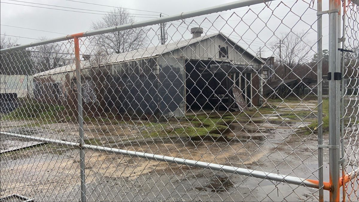 The gutted building behind chainlink fence where the Abby Singer pub will reside at Pratt Pullman in Kirkwood, Atlanta