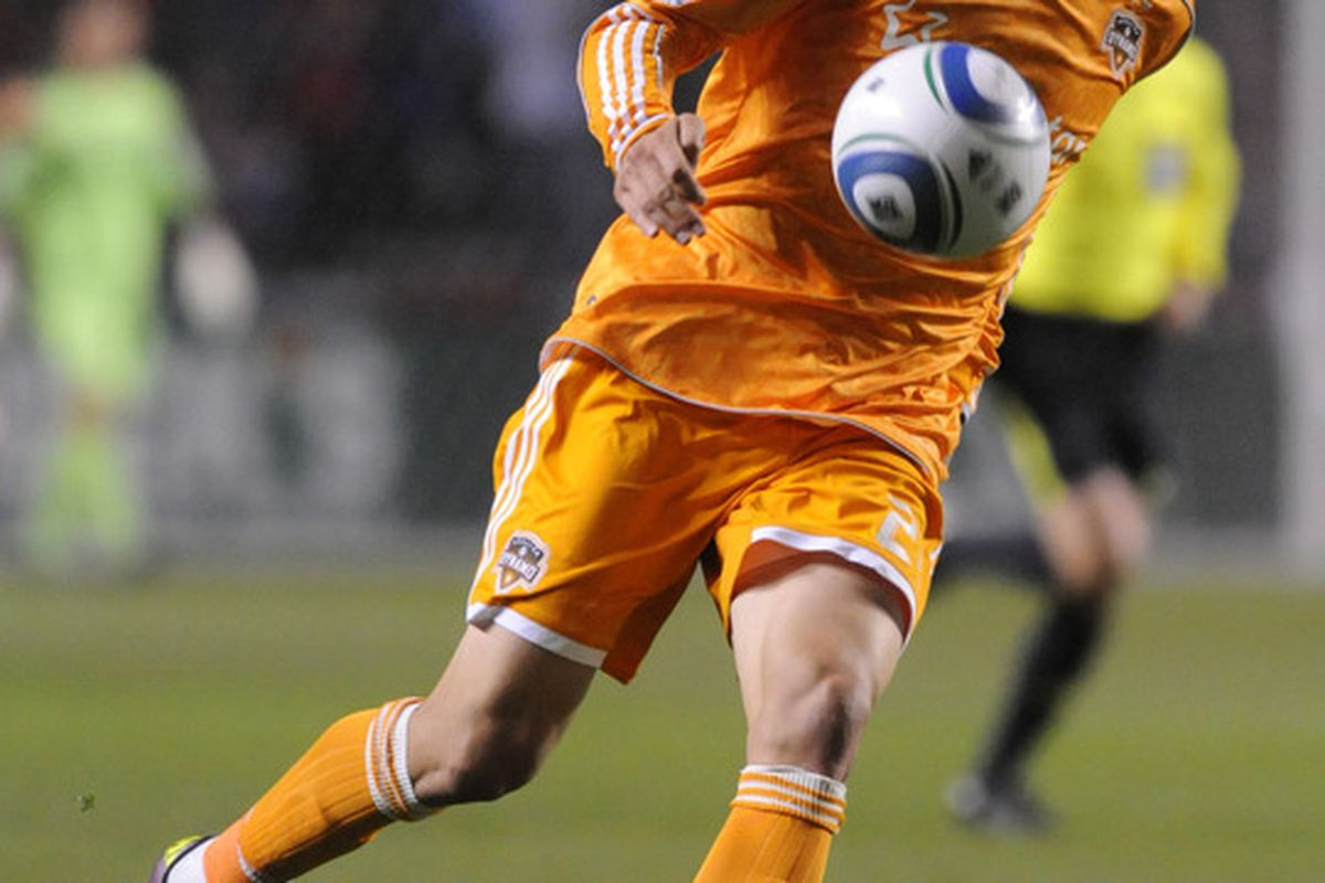 BRIDGEVIEW, IL - APRIL 23: Geoff Cameron #20 of the Houston Dynamo brings the ball up the field against the  Chicago Fire in an MLS match on April 23, 2011 at Toyota Park in Bridgeview, Illinois.  (Photo by David Banks/Getty Images)
