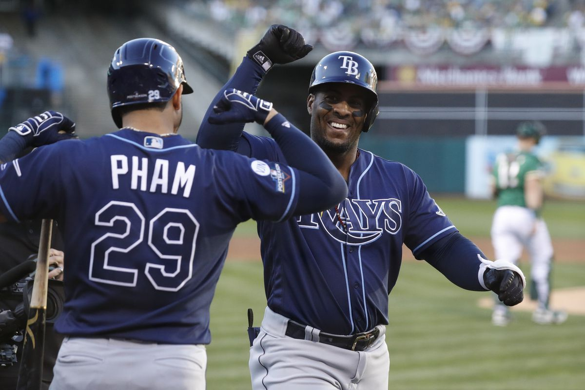 Tampa Bay Rays first baseman Yandy Diaz celebrates with designated hitter Tommy Pham after hitting his second home run of the game against the Oakland Athletics during the third inning of the 2019 American League Wild Card playoff baseball game.