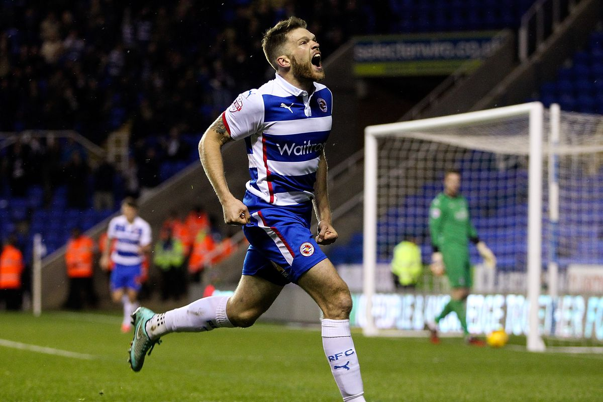 Jamie Mackie absolutely hating wearing the Reading shirt.